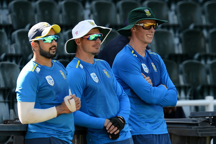 Tabraiz Shamsi , Dale Steyn and Rassie van der Dussen watch training from the sidelines at Bidvest Wanderers on March 1 2019.