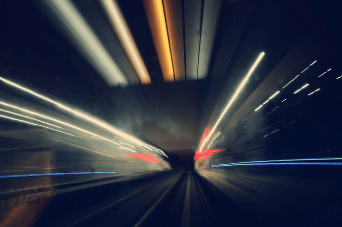 camera trick with lights to create the perception of speed against a black background