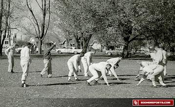 Photo: Wilkinson, far left, oversees a Sooner practice.