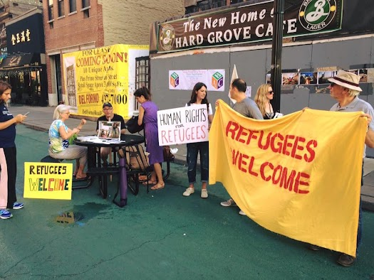 JCVR's weekly vigil spreads awareness of the growing refugee crisis, and serves as hub for conversation and coordination for volunteers.