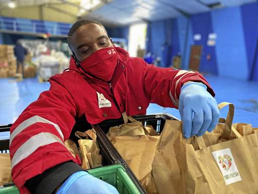 No more queues: A Yebo Fresh worker packs bags of groceries. Picture: GG Alcock
