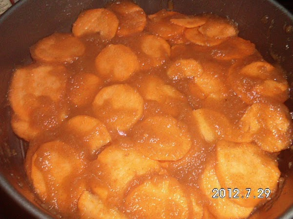Pour sliced potatoes into bowl and make sure each potato is coated on both...