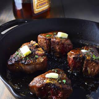 Cast Iron Lamb Loin Chops with Herbs and Cognac Butter Sauce.
