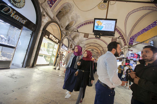 inside-grand-bazaar.jpg - Visitors eye the boutique stores along the main hallway of the Grand Bazaar in Istanbul.