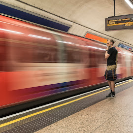 On his way to Woodford by David Feuerhelm - Transportation Trains ( underground, blur, long exposure, man, train )