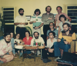 Photo: UM Computing Center, Merit Network staff, and friends, c. 1981, left to right, bottom row: Bob Husak (Merit), Shifrah Nenner (friend), Gail Lift, Alisande Cutler (friend), Mike Alexander, Don Boettner, Dick Salisbury, middle row: Jim Sterken, Chris Wendt (Merit), top row: Jeff Ogden, Andy Goodrich, Gavin Eadie, Fred Swartz