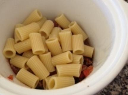 Once the pasta is half-cooked, add it to the meat and cook on low...