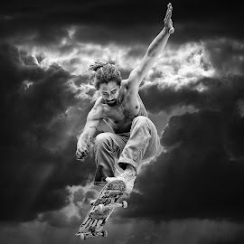 Perfect Jump ! by Marco Bertamé - Black & White Sports ( clouds, flying, kateboarding, dramatic, young, skateboard, man, jump )