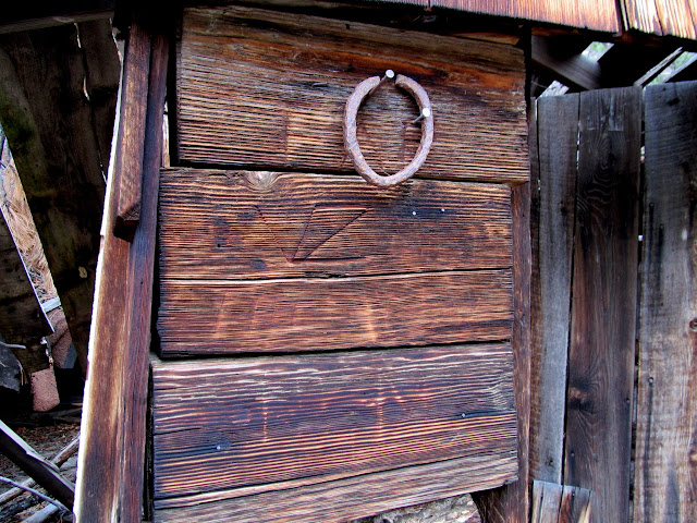 Initials carved into the cabin