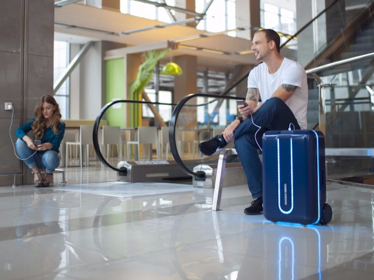 "The ""robot suitcase"" from California-based startup Travelmate can be controlled with a smartphone app and can roll alongside its owner at speeds up to 11 kilometers per hour, navigating around obstacles."