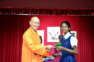 Photo: Neharikha who has done well in PSLE, receiving the Award from Swamiji