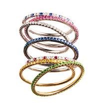 Photo: MARITN KATZ Diamond, sapphire and tsavorite microband stackable ring. Available in sizes 4–8. $2,500. Main Floor. 212 872 8775