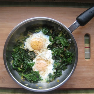Skillet-Poached Eggs with Spinach, Pea Tendrils, and Leeks.
