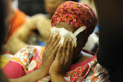 Bertha Molefe, who lost her daughter breaks down during the hearings. File photo