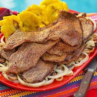 Bistec Encebollado -- Steak with Onions.