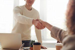 a person shaking hands with their real estate agent