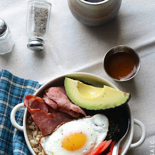 Savory Oatmeal Breakfast Bowls with Smoky Garlic Greens and Chipotle-Honey Vinaigrette