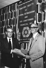 Photo: Jim Black (pr) hands Life Membership Certificate to Ed Schoenherr (pr 1955-56), Charter Member