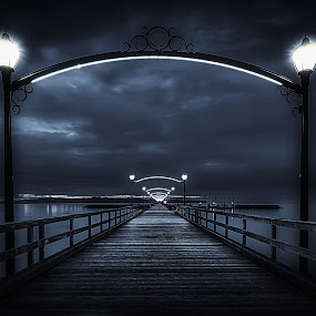Mystical Pier - B&W by Garry Dosa - Black & White Buildings & Architecture ( lights, water, eerie, b&w, mystical, blue, black & white, pier, ocean, toned,  )