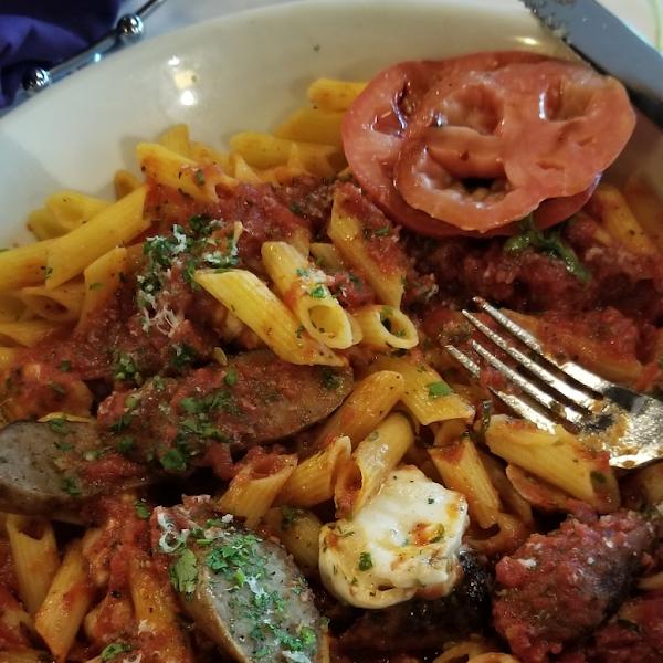 GF pasta with tomato basil sauce, plus sausage and chicken.