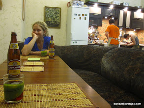 Photo: Liz and I enjoy a beer while our hosts Georgy and Yulia prepare dinner