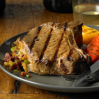 Grilled Pork Chops with Chorizo, Dates and Manchego Stuffing.