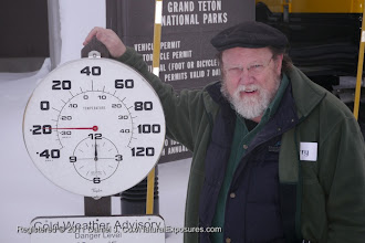Photo: Larry Johnson poses next to the thermometer registering -20F at the  entrance of Yellowstone National Park, Wyoming.