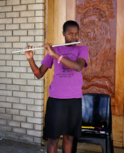 Photo: Anastasia practicing the flute by the lion door.