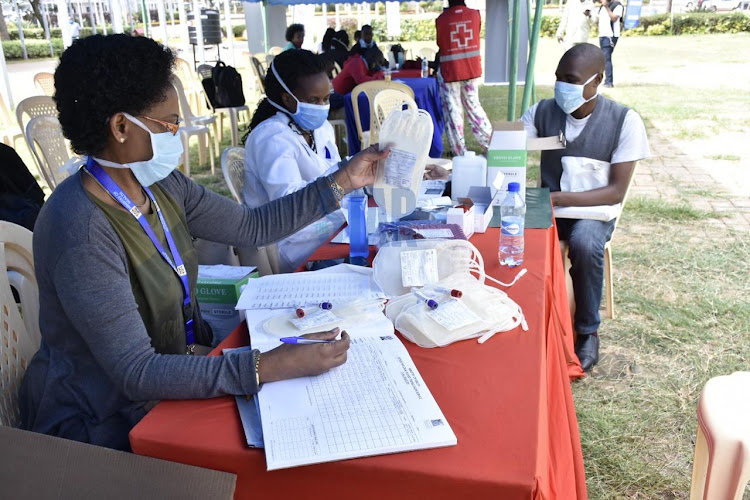 Medical practitioners from National Blood Transfusion Service takes personal details of blood donors before donation at KICC Comesa grounds on June 12,2020.