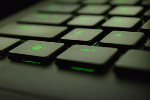 Close-up Photography of Black and Green Computer Keyboard Keys