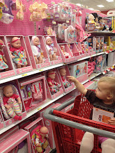 Photo: We had to make a stop in the baby section. It was what she begged for from the time we walked in the store.