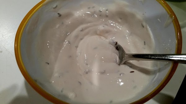 In a medium bowl, toss cabbage and onion.In a small dish, mix sour cream,...