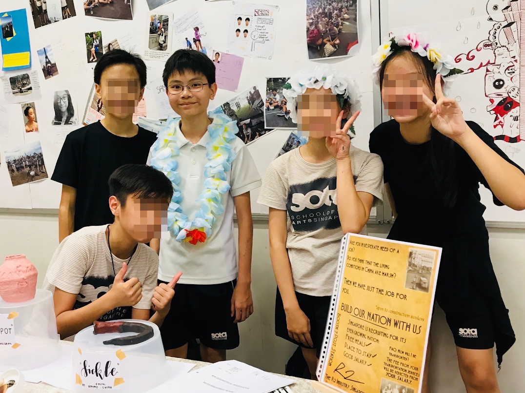 Some of my classmates and I at our humanities booth.