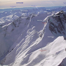 Photo: Hautes Pyrénées : vision aérienne hivernale sur les faces Nord et Est du Vignemale. Belle vue sur le glacier d'Ossoue surplombé par les crêtes du pic de Cerbillona au Grand Tapou à gauche. Dans le champ de neige juste devant vous devinerez le refuge de Beysselance