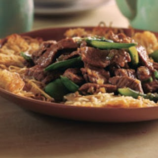 Crispy Noodles With Beef And Snowpeas.