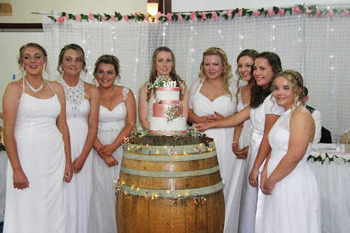 The debs cut the cake, one of the highlights at the annual Wee Waa Debutante Ball, Libbee Anderson, Madison Doring, Georgia Cone, Faith Pagett, Georgia Dickinson, Amelia Cruickshank, Georgie Johnson and Zoe Conomos. The cake was made by Deborah Trindall of Deb's Cakes.