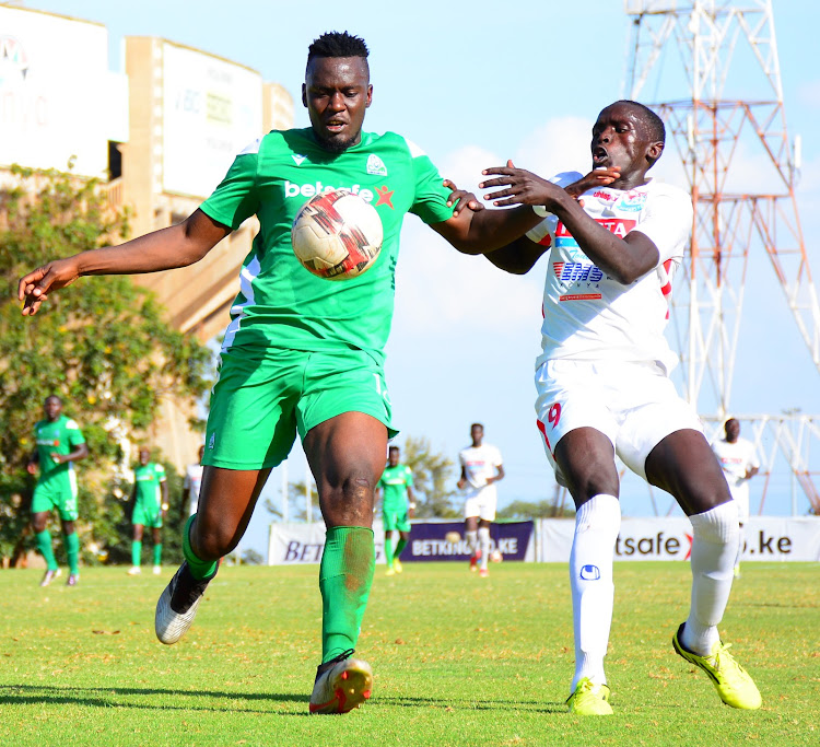 Gor Mahia's Harun Shakava (L) battles for ball possession with Josephat Lopaga of Posta Rangers during their Premier League clash at Moi Stadium, Kasarani