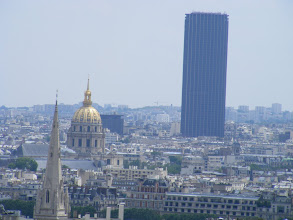 Photo: Here, the Invalides dome and the Montparnasse Tower are seen. The view from the top of the tower is excellent, although we did not ascend on this trip. A popular local saying is that the best thing about the view from the Montparnasse Tower is that one cannot see the Montparnasse Tower! It is also disparagingly called l'asperge (the asparagus) for the sense of a single large stalk sticking out of the ground. In fact, two years after its1972 completion, the construction of skyscrapers in the city center was banned.