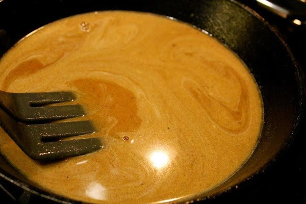 Slowly, constantly mixing, bring gravy to a slow boil. Remove from heat.