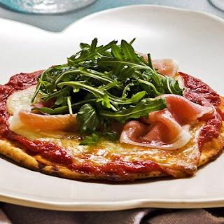 Mini Pita Pizzas With Mozzarella Prosciutto And Rocket.