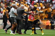 Kaizer Chiefs coach Ernst Middendrop and Shaun Bartlett celebrates with Bernard Parker during the Absa Premiership match between Kaizer Chiefs and Orlando Pirates at FNB Stadium on November 09, 2019 in Johannesburg, South Africa.