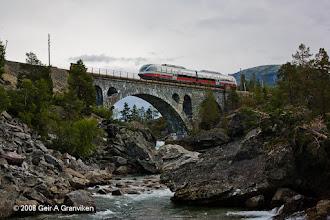 Photo: NSB BM93 diesel powered Multiple Unit crossing Stuguflåten bridge on the Rauma line in Romsdalen