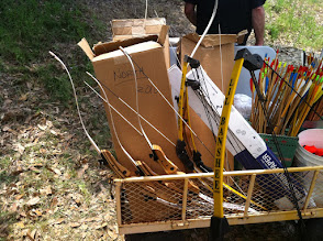 Photo: Archery cart with Lil Banshee compound bows