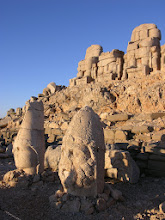 Photo: Ancient stone heads and funerary mound on top of Mt. Nemrut, Eastern Terrace, at dawn.