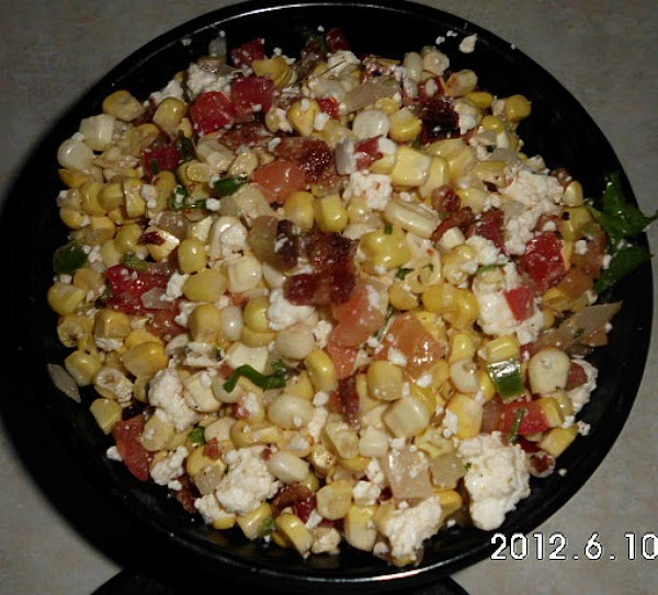 To corn add: pico de gallo, crumbled bacon , dressing, salt and pepper to...
