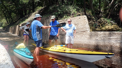 Photo: Mick snaps the paddle together while Scott and Mark watch