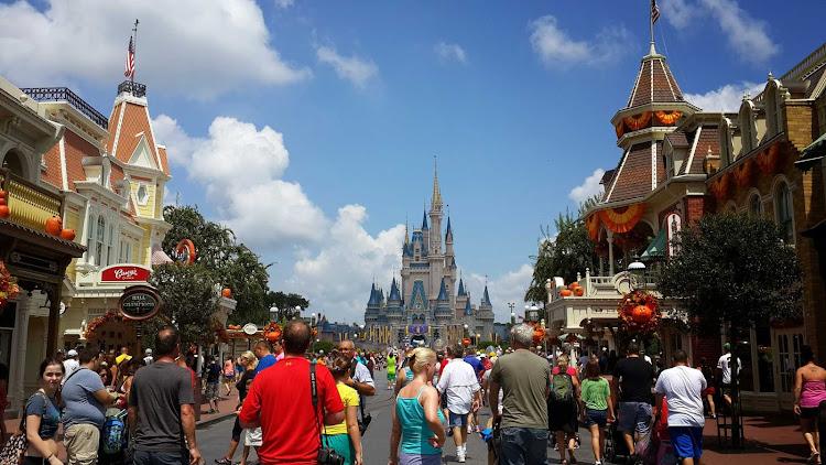 Visits make their way down Main Street USA at Walt Disney World Resort in Orlando, Fla.
