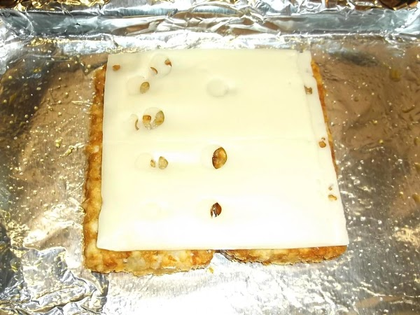 Place swiss cheese slices on top. (Reduce oven heat to low and keep warm...
