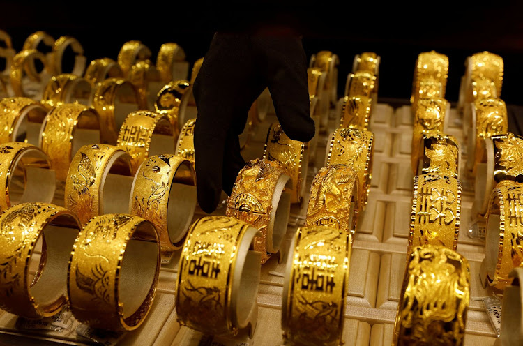 A salesperson arranges gold bracelets for Chinese weddings at the Chow Tai Fook Jewellery store in Hong Kong, China. Picute: REUTERS/TYRONE SIU/FILE PHOTO