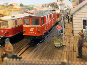 Photo: 015 Two Austrian tourist trains at the pierhead terminus. Note the very realistically modelled wooden planking on the pier deck .